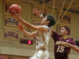 Varsity Basketball defeats defending CHSAA Champs Christ the King