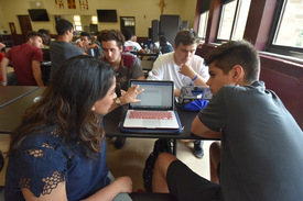 "Asma Malik, Associate Director of Admissions at Syracuse University, left, works with Iona Preparatory rising senior David Pereira, 16, of White Plains, during the ""College Essay Boot Camp."""